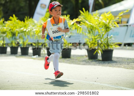 PHUKET, THAILAND - MAY 07: Unidentified young athletes run in a Kids' Run race during  the Laguna Phuket  International marathon at Laguna on May 07, 2015 in Phuket, Thailand. - stock photo