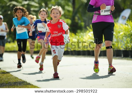 PHUKET, THAILAND - MAY 07: Unidentified young athletes run in a Kids' Run race during  the Laguna Phuket  International marathon at Laguna on May 07, 2015 in Phuket, Thailand. - stock photo