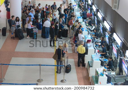 PHUKET, THAILAND - 21 NOV 2013: Passenger queue near check-in desks in Phuket international airport - stock photo
