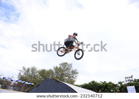 PHUKET THAILAND-Nov18:Unidentified bmx rider of Korea jumps during a performance during the  BMX Park - Best Trick  in 2014 Asian Beach Games at Saphan Hin on November18, 2014 in Thailand