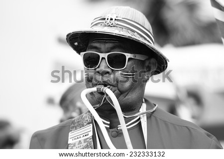 PHUKET THAILAND-NOV21:unidentified fan of Thailand during the Beach Volleyball match between Iran and Thailand the 2014 Asian Beach Games at Karon beach on NOVEMBER21,2014 in Thailand