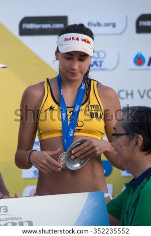 PHUKET, THAILAND-NOVEMBER 3: Carolina Solberg Salgado of Brazil during medal presentation ceremony of Phuket Open on November 3, 2013 at Karon Beach in Phuket Thailand