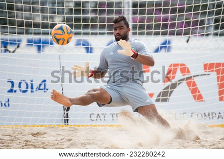 PHUKET THAILAND-NOVEMBER20 :Goalkeeper Humaid Alblooshi of UAE in action during the Beach Soccer match between UAE and Iran the 2014 Asian Beach Games at Saphan Hin on Nov 20,2014 in Thailand - stock photo