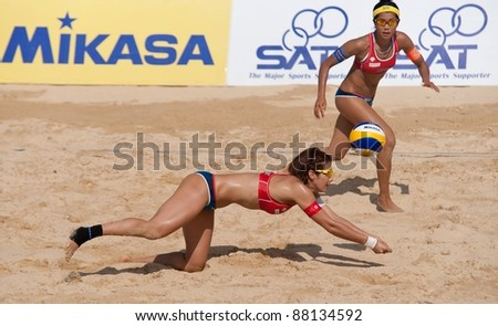 PHUKET, THAILAND - NOVEMBER 2: Satoko Urata & Takemi Nishibori of Japan in action during day 2 of the SWATCH FIVB World Tour 2011 on November 2, 2011 at Karon Beach in Phuket, Thailand