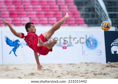 PHUKET THAILAND-NOVEMBER15:Tran Van Hoa of Vietnam in action during the Beach Soccer match between Kuwait and Vietnam the 2014 Asian Beach Games at Saphan Hin on November15,2014 in Thailand - stock photo