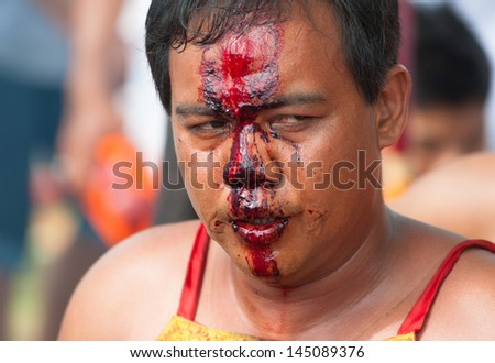 PHUKET, THAILAND- OCT 23: Unidentified participant of parade on October 23, 2012 Vegetarian Festival Phuket Thailand. The Festival is a famous annual festival also known as Nine Emperor Gods festival - stock photo