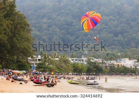 PHUKET, THAILAND - October 3, 2015: Peoples enjoy parasailing at Patong beach in Phuket,Thailand on OCT 3, 2015. Patong beach is popular beach for water sport.