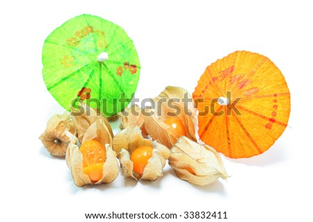 Physalis decorated with cocktail umbrellas, isolated on white with shadows - stock photo