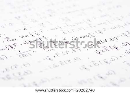 Physical equations (electromagnetics) hand written on paper
