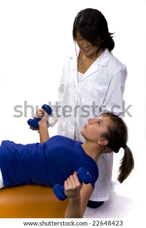 physical therapist helps a patient on a roll