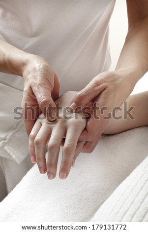 physical therapist massaging hands - stock photo