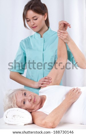 Physical therapy exercises for elderly patient's arm - stock photo