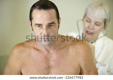 Physician Checking Patient's Lungs - stock photo