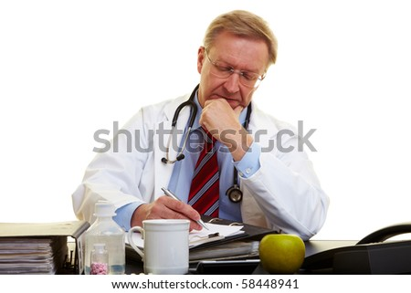 Physician sitting at a desk and taking notes