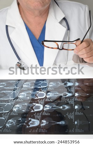 Physician  with white coat and a CT Scan/Doctor and CT Scan/Doctor with stethoscope and lab coat and a CT scan - stock photo