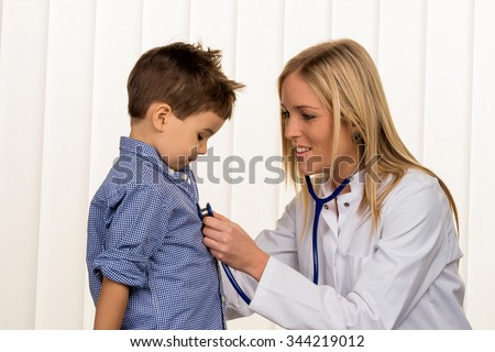 physicians and little boy, a symbol of disease, diagnosis, heart failure - stock photo