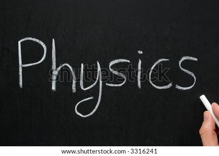 Physics, written with white chalk on a blackboard. - stock photo