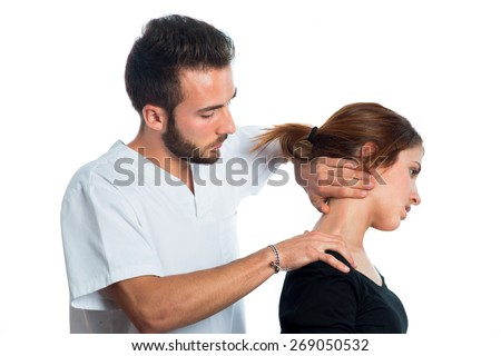 physiotherapist / masseur giving a neck massage to a young girl isolated on white background - stock photo