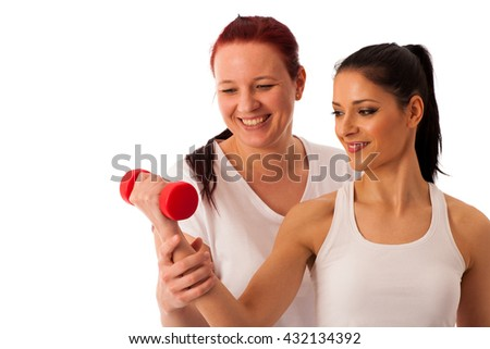Physiotherapy - therapist doing arm  exercises with dumbbells for improving arm strength and coordination  with a patient to recover  after injury - stock photo