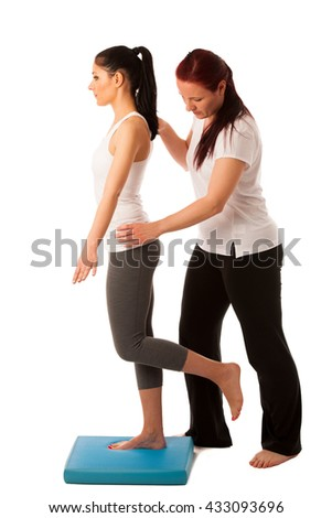 Physiotherapy - therapist doing   exercises for improving coordination and stability with a patient to recover  after injury