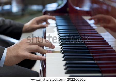 Pianist Hands Playing Classical Piano Music - stock photo