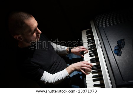 Pianist playing on electric piano - stock photo