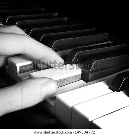 Pianist playing piano - stock photo