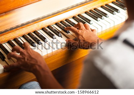 Pianist playing with selective focus on fingers - stock photo