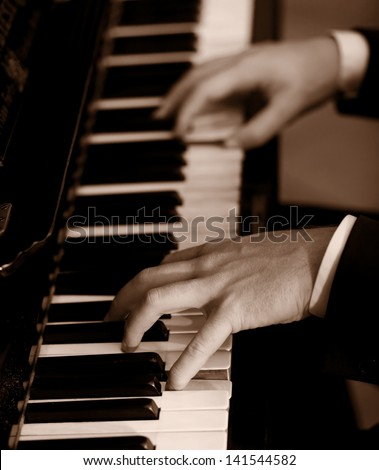 Pianist - sepia toned - stock photo