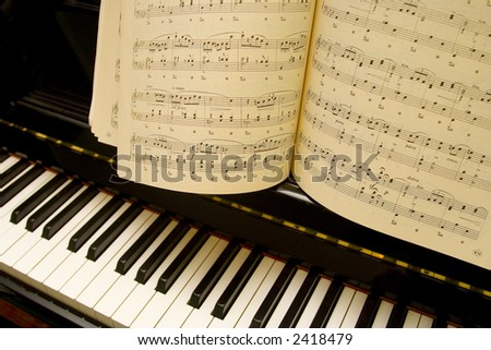 Piano and lyrics book, focus on notes - stock photo