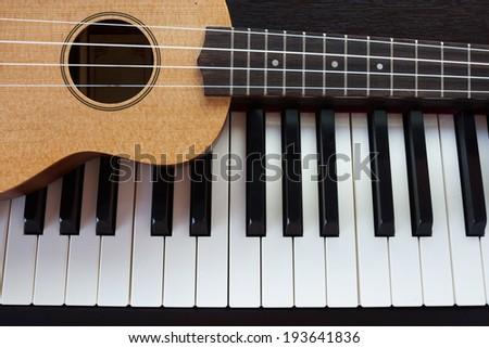 Piano and Ukulele - stock photo