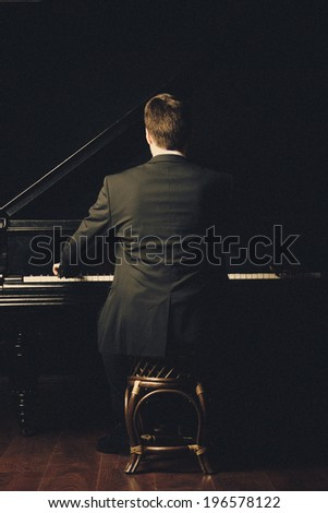 Piano classical music musician player. Pianist with musical instrument grand piano - stock photo