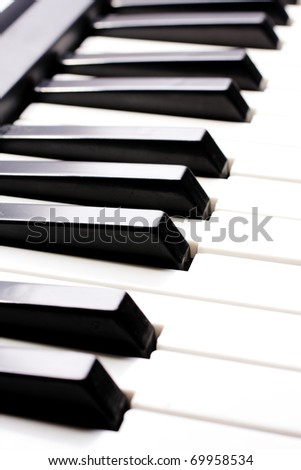piano close up on the keyboard - stock photo
