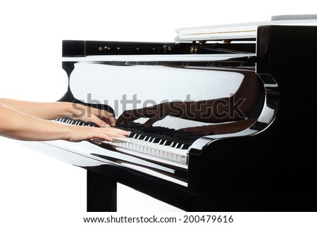 Piano hands closeup music instrument details Pianist playing grand piano - stock photo