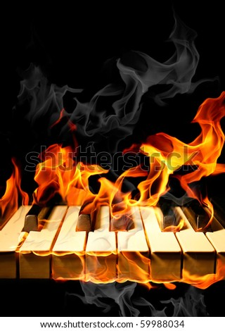 Piano in flames - stock photo