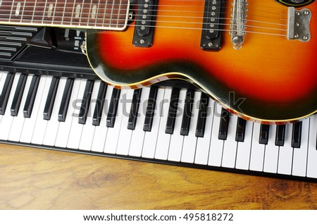 Piano keyboard and electric guitar
