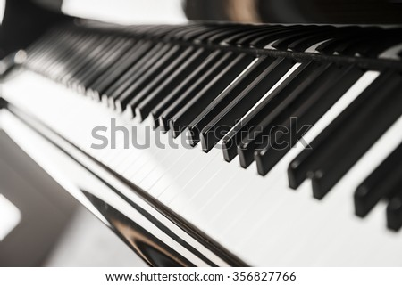 Piano keyboard background with selective focus. Lateral view - stock photo