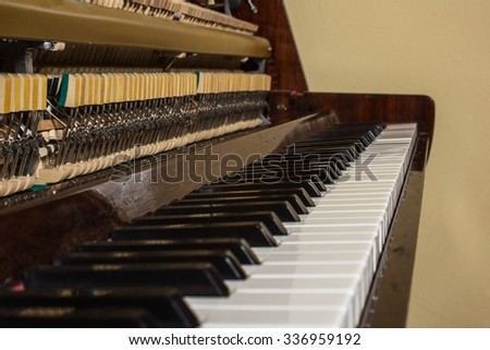 Piano keyboard background with selective focus. Warm color toned image - stock photo