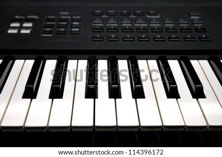 Piano keyboard close up of monochrome - stock photo