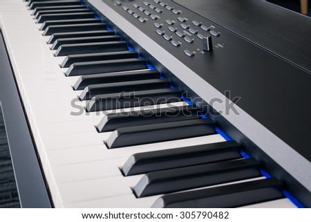 Piano Keyboard synthesizer closeup key frontal view - stock photo
