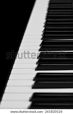 Piano keys closeup in black and white - stock photo