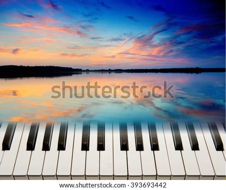 Piano keys in a landscape. - stock photo