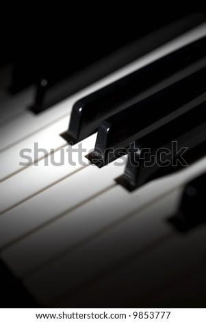 piano keys selective lighting - stock photo