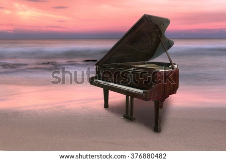 Piano outside shot at beach during sunset - stock photo