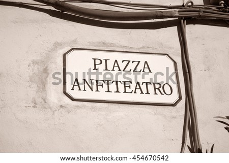 Piazza Anfiteatro Square Sign, Lucca, Italy in Black and White Sepia Tone