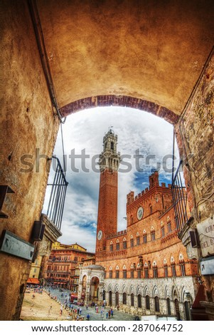 Piazza del Campo in Siena seen from an arch, Italy - stock photo
