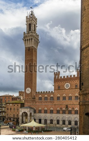Piazza del Campo is the principal public space of the historic center of Siena, Tuscany, Italy and is regarded as one of Europe's greatest medieval squares. - stock photo