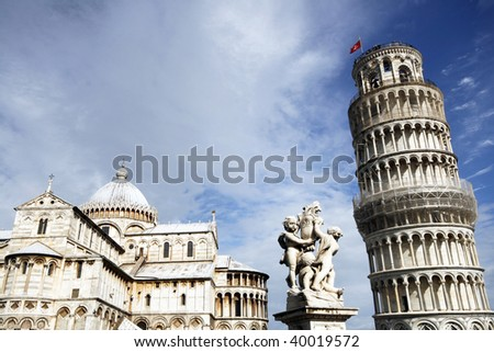 Piazza del Duomo (Piazza dei Miracoli) with famous landmarks of Pisa - Duomo cathedral, cherubs statue and leaning tower. It is UNESCO World Heritage Site. - stock photo