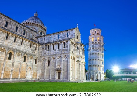 Piazza del Duomo with Pisa tower and the Cathedral illuminated at night, Pisa, Italy