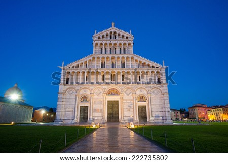 Piazza del Duomo with the Basilica entrance illuminated at night, Pisa, Italy